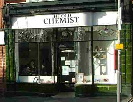 old chemist shop front from across road