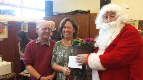 cobbett christmas fayre 2017santa hands over goodiesjpg