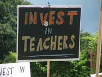 invest in teachers sign
