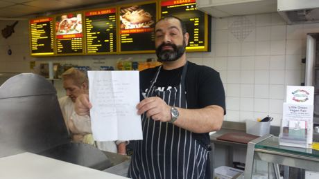 nick nicolaou with letter