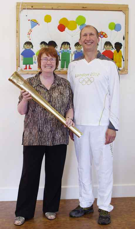 Heather Bruce Elkins and olympic torch reduced