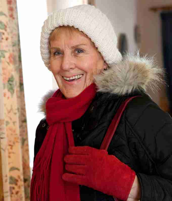 person in hat scarf and gloves Credit Age UK
