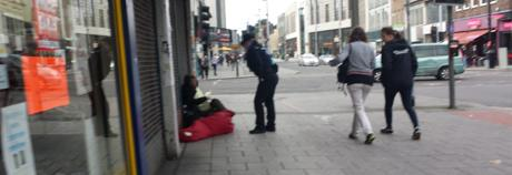 person on street with police officer